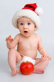 Surprised infant with Christmas cap Stock Image
