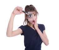 Surprised isolated businesswoman holding magnifying glasses. Royalty Free Stock Photos