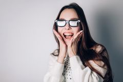 Surprised joyful beautiful woman girl in 3d glasses on white background. virtual reality, cinema, modern technology. Surprised joyful beautiful woman girl in 3d Royalty Free Stock Image