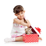 Surprised kid girl opening gift box with kitten Stock Image