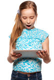 Surprised kid with a Tablet PC Stock Photos