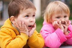 Surprised kids. Preschool boy and girl looks surprised Stock Image