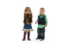 Surprised kids. Preschool boy and girl wearing fashionable clothes, looks surprised Stock Photos