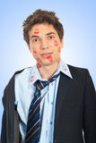 Surprised kissed man. In business suit over blue background Royalty Free Stock Photography