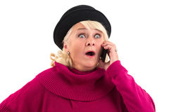 Surprised lady with cell phone. Stock Photo