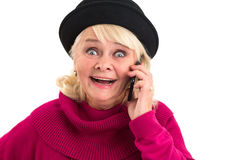 Surprised lady holding cell phone. Stock Images