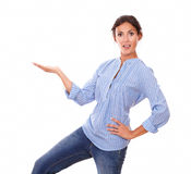 Surprised lady holding her right palm up Stock Images