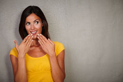 Surprised lady looking away with hands to mouth Stock Photography