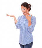 Surprised latin lady holding her right palm up Royalty Free Stock Photography