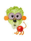Surprised lion made of vegetables on white background. Funny lion made of salad, carrot, tomato, onion and olive. Easy and fun way to make healthy lunch for Royalty Free Stock Photos