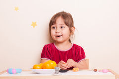 Surprised litle girl at the desk Royalty Free Stock Images