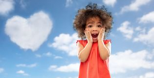 Surprised little african american girl over sky royalty free stock photos