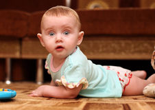 Surprised Baby on the Floor Stock Images