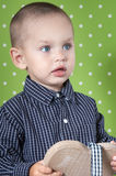 Surprised a little boy  holding a wooden heart Stock Image
