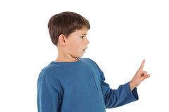 Surprised little boy pointing up Royalty Free Stock Images