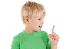 Surprised little boy pointing up Stock Image