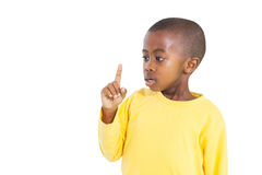 Surprised little boy pointing up Stock Images