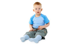 Surprised little boy sitting on white Stock Images