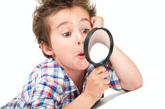 Surprised little boy with weird Stock Photography