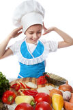 Surprised little cook dropping a plate with salad Stock Images