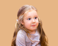 Surprised little girl with big eyes Royalty Free Stock Photography