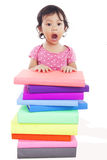 Surprised little girl with books Royalty Free Stock Photo