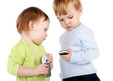 Surprised little girl and boy with the phone Stock Image