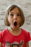 Surprised Little Girl with Funny Face Stock Photo