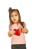 Surprised little girl holding heart Stock Images