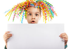 Surprised little girl holding a poster Stock Photo
