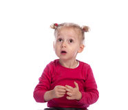 Surprised little girl making big eyes, looking up Royalty Free Stock Image