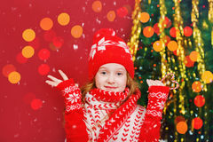 Surprised little girl near christmas fir tree. Royalty Free Stock Images