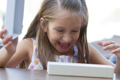 Surprised little girl opens a present Royalty Free Stock Photography