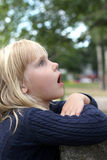 Surprised little girl outdoors Royalty Free Stock Images