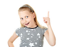 Surprised little girl pointing with finger Stock Image