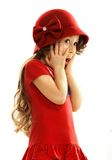 Surprised little girl in red dress Royalty Free Stock Image