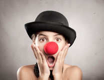 Surprised little girl with a red nose Stock Photos