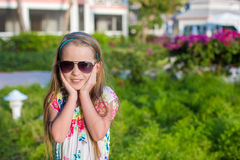 Surprised little girl on summer vacation Stock Photo