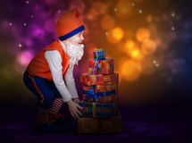Surprised little gnome with gift boxes Stock Photos