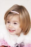 Surprised little princess. Portrait of happy liitle girl wearing Christmas costume Stock Image