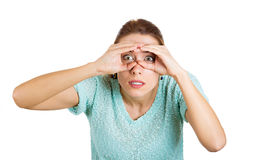 Surprised looking through binoculars Royalty Free Stock Images