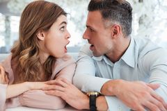 Surprised Lovely couple looking to each other Royalty Free Stock Photo