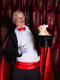 Surprised magician with rabbit Stock Images
