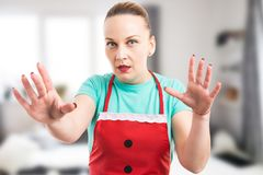 Surprised maid or housekeeper scared of the camera royalty free stock image