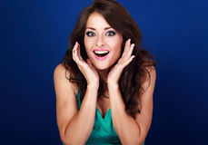 Surprised makeup woman with opened mouth and big eyes with hands Royalty Free Stock Image