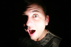 Surprised Man. A surprised man with a dark background Stock Photography