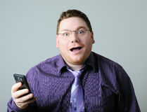 Surprised man. With mobile phone Stock Photography