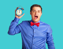 Surprised man with alarm clock Royalty Free Stock Image