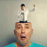 Surprised man with angry businessman Royalty Free Stock Photography