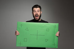 The surprised man as businessman with green panel Royalty Free Stock Photography